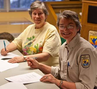 Barbara Volkle (President of the Friends of Assabet River NWR) and Libby Herland (Eastern Massachusetts National Wildlife Refuge Project Leader) sign the agreement