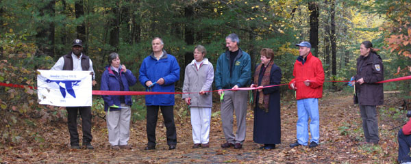 Cutting the ribbon at the opening of the Refuge. Photo courtesy of Timothy Coyne.